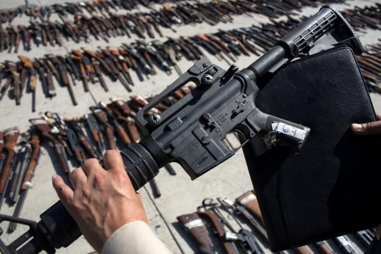 Seized weapons are seen at a Mexican military base in the border city of Tijuana before being destroyed (AFP/GUILLERMO ARIAS)