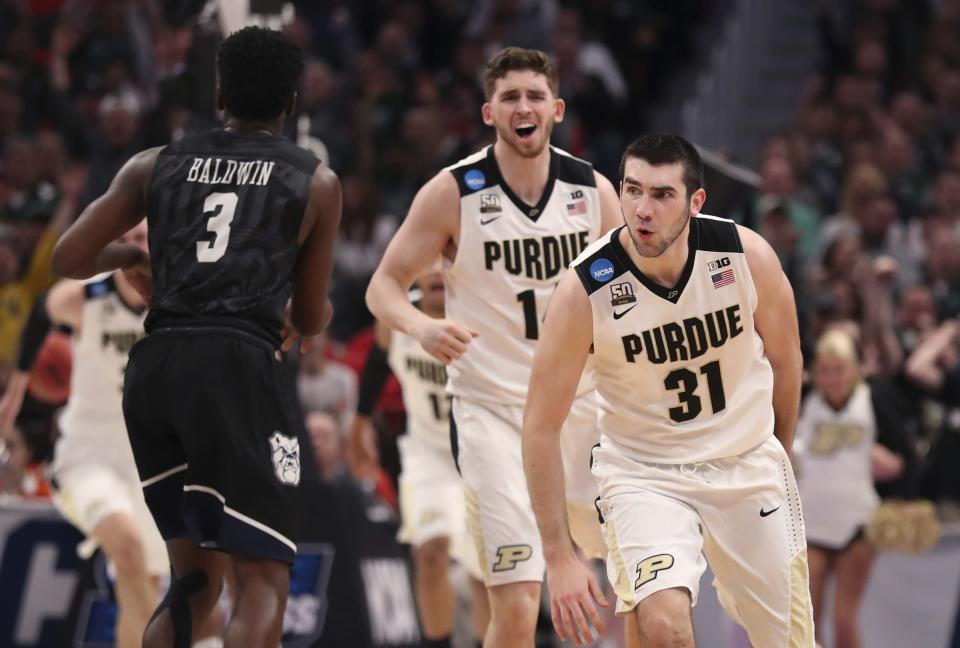 Purdue guards Ryan Cline and Dakota Mathias (31) celebrate as their team defeats Butler during the second half of a second-round game in the NCAA college basketball tournament, Sunday, March 18, 2018, in Detroit. (AP Photo/Carlos Osorio)