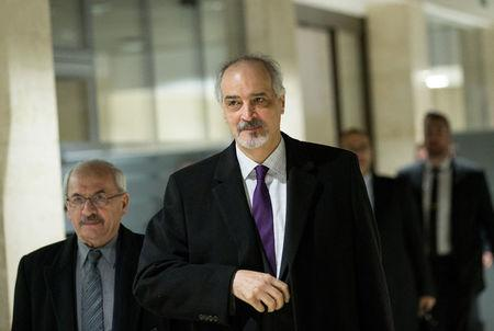Syrian Ambassador to the United Nations and head of the government delegation Bashar al-Jaafari (front) arrives for a meeting of Intra-Syria peace talks UN Special Envoy for Syria Staffan de Mistura  at Palais des Nations in Gen