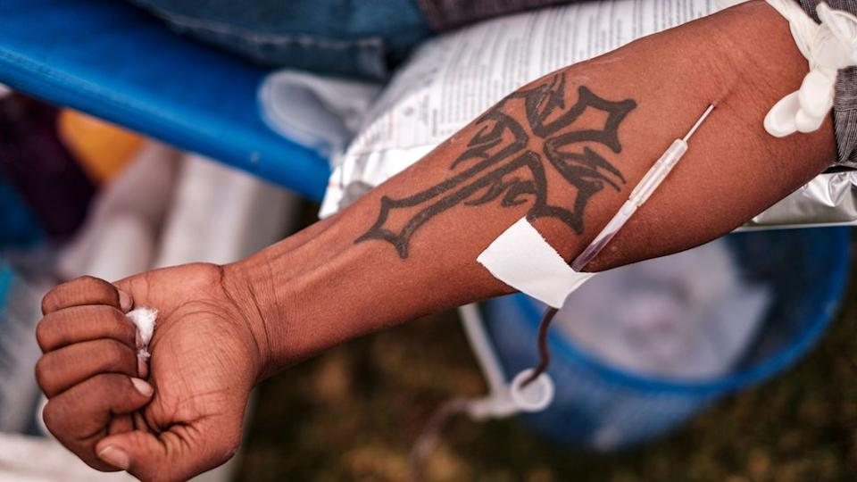 The tattooed arm of a man giving blood in Addis Ababa, Ethiopia - 12 November 2020