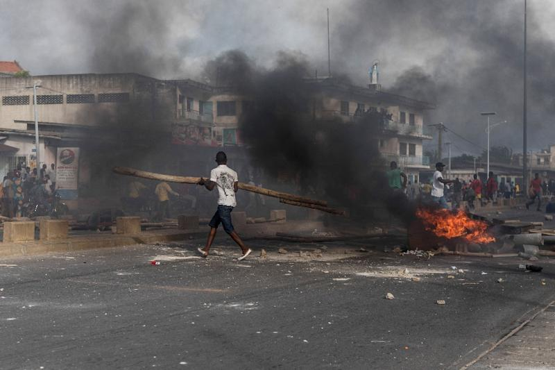 Smoke rises from a barricade in Wednesday's unrest (AFP Photo/Yanick Folly)