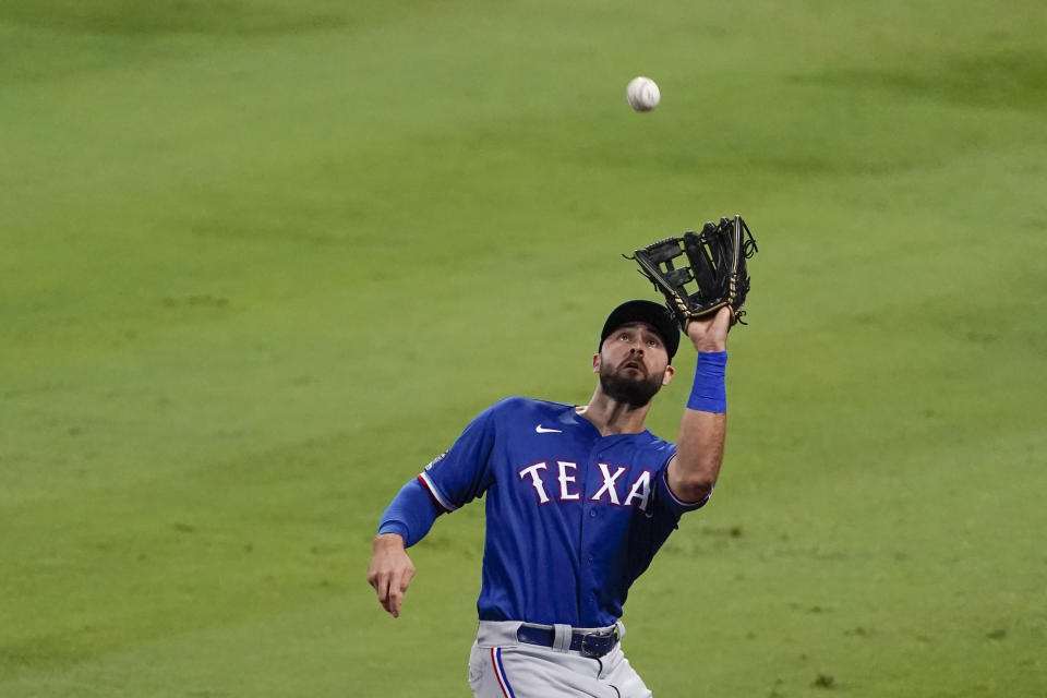 Texas Rangers right fielder Joey Gallo catches a foul ball hit by Los Angeles Angels' Mike Trout during the third inning of a baseball game Friday, Sept. 18, 2020, in Anaheim, Calif. (AP Photo/Ashley Landis)