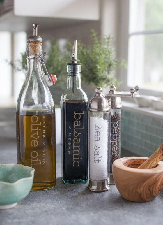 "<p>Use your favorite font to make sure your bottles of oil and vinegar stand out on your counter and fit your decor. These chic bottles were made using transfer sheets and a <span class=""redactor-unlink"">Cricut Explore.</span></p><p>Get the tutorial at <a href=""http://liagriffith.com/stylishly-label-your-olive-oil-vinegar-salt-pepper-grinders/"" rel=""nofollow noopener"" target=""_blank"" data-ylk=""slk:Lia Griffith"" class=""link rapid-noclick-resp"">Lia Griffith</a>.</p>"