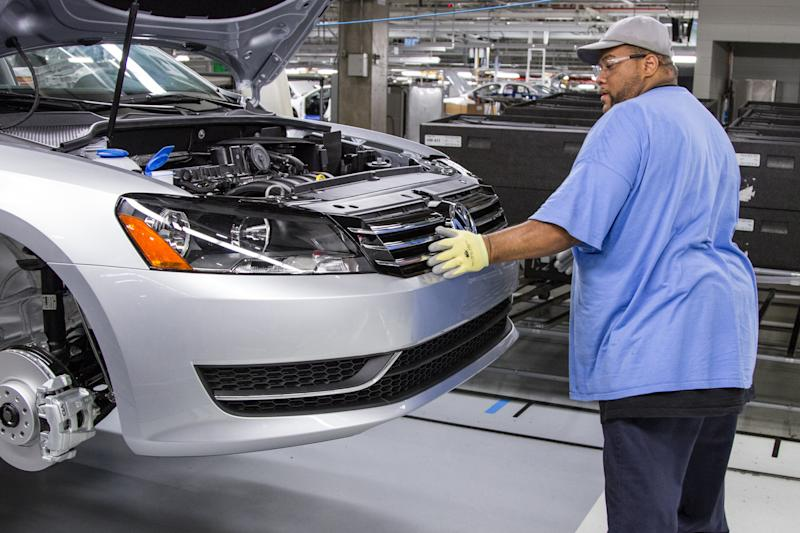In this July 12, 2013, photo, an employee at the Volkswagen plant in Chattanooga, Tenn., works on the assembly of a Passat sedan. Efforts by the United Auto Worker to unionize the plant have raised concerns among southern Republicans, who worry that the move would hurt the region's ability to lure foreign automakers in the future. (AP Photo/Erik Schelzig)