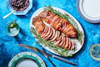 """Wrap pork tenderloin in bacon and you'll barely have to worry about it drying out as the rich fat bastes the roast as it renders. <a href=""""https://www.epicurious.com/recipes/food/views/christmas-pork-tenderloin?mbid=synd_yahoo_rss"""" rel=""""nofollow noopener"""" target=""""_blank"""" data-ylk=""""slk:See recipe."""" class=""""link rapid-noclick-resp"""">See recipe.</a>"""