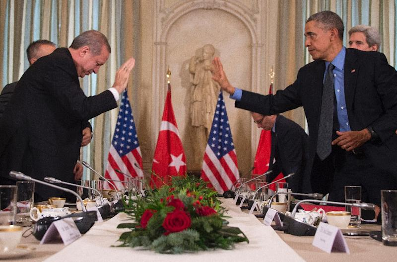 """US President Barack Obama (right) greets his Turkish counterpart Recep Tayyip Erdogan ahead of a meeting in Paris, on December 1, 2015 World leaders opened an historic summit in the French capital with """"the hope of all of humanity"""" laid on their shoulders as they sought a deal to tame calamitous climate change. (AFP Photo/Jim Watson)"""
