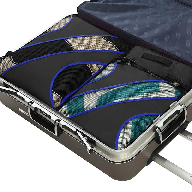 The set includes four lightweight cubes — an extra large, large, medium and small organizer — and each features double zipper pulls, mesh panelling and a top handle for convenience. (Photo: Amazon)