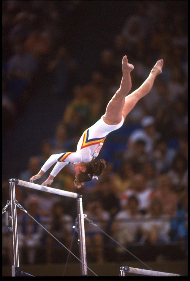 5 AUG 1984: ECATERINA SZABO OF ROMANIA IN ACTION DURING HER ROUTINE ON THE ASSYMETRICAL BARS AT THE 1984 LOS ANGELES OLYMPICS.