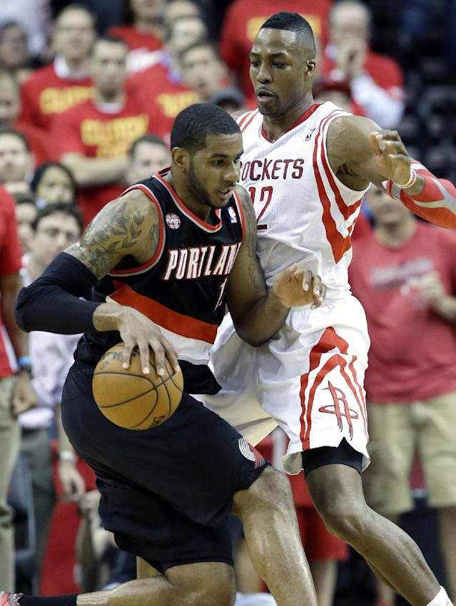 Portland Trail Blazers' LaMarcus Aldridge, left, pushes against Houston Rockets' Dwight Howard (12) in the second half of Game 5 of an opening-round NBA basketball playoff series Wednesday, April 30, 2014, in Houston. The Rockets won 108-98 to send the teams back to Portland for Game 6. (AP Photo/Pat Sullivan)