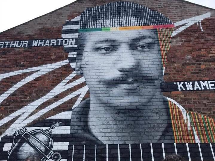 The street mural in Darlington also bears the name Wharton's Ghanaian family knew him by, KwameArthur Wharton Foundation