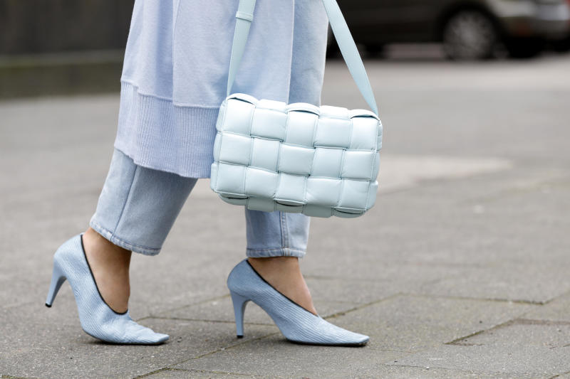 DUESSELDORF, GERMANY - MARCH 19: A topaz colored padded cassette bag and topaz colored crunch sharpei pumps by Bottega Veneta as a detail of influencer Gitta Banko during a street style shooting on March 19, 2020 in Duesseldorf, Germany. (Photo by Isa Foltin/Getty Images)