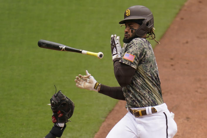 San Diego Padres' Fernando Tatis Jr. moves back from an inside pitch while batting during the fourth inning of a baseball game against the San Francisco Giants, Sunday, May 2, 2021, in San Diego. (AP Photo/Gregory Bull)