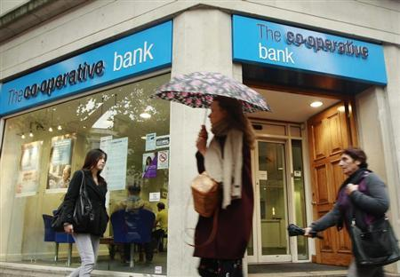 People pass by a branch of The Co-operative Bank in London