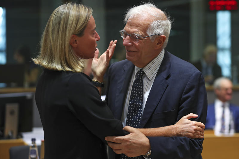 European Union foreign policy chief Federica Mogherini, left, talks to Spain's Foreign Minister Josep Borrell during a European Foreign Affairs meeting at the European Council headquarters in Brussels, Monday, July 15, 2019. European Union nations were looking to deescalate tensions in the Persian Gulf area on Monday and call on Iran to stick to the 2015 nuclear deal, despite the pullout of the United States from the accord and the re-imposition of U.S. sanctions on Tehran. (AP Photo/Francisco Seco)