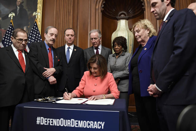 Nancy Pelosi signs the resolution to transmit the two articles of impeachment against President Trump to the Senate. (Photo: Susan Walsh/AP)
