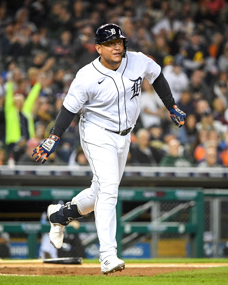 Miguel Cabrera of the Detroit Tigers doubles on a line drive to Hunter Dozier of the Kansas City Royals during the bottom of the sixth inning at Comerica Park on Sept. 25, 2021 in Detroit.