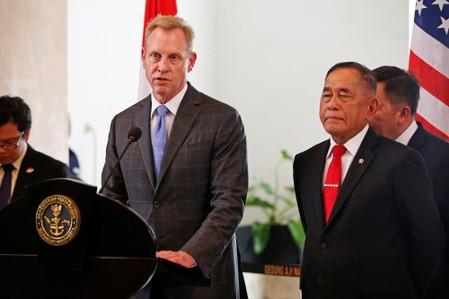 U.S. Defense Secretary Patrick Shanahan talks next to his Indonesian counterpart Ryamizard Ryacudu during a press briefing after their meeting in Jakarta