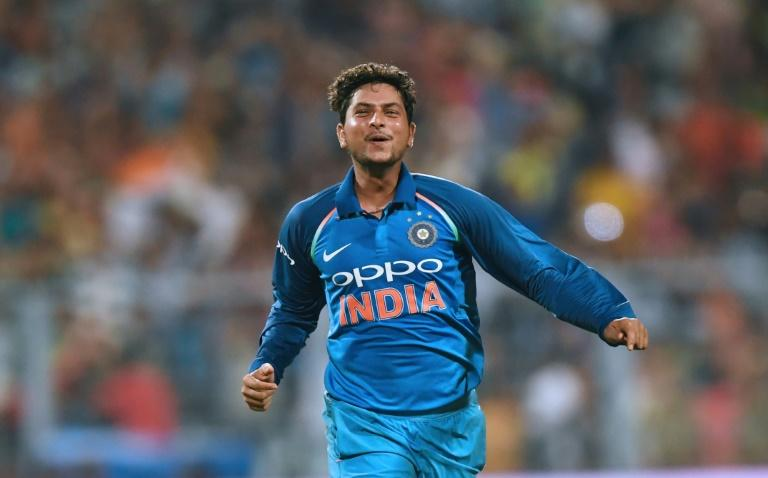 India's Kuldeep Yadav celebrates after completing his hat-trick after taking the wicket of Australia's Pat Cummins during the second ODI match in Kolkata on September 21, 2017