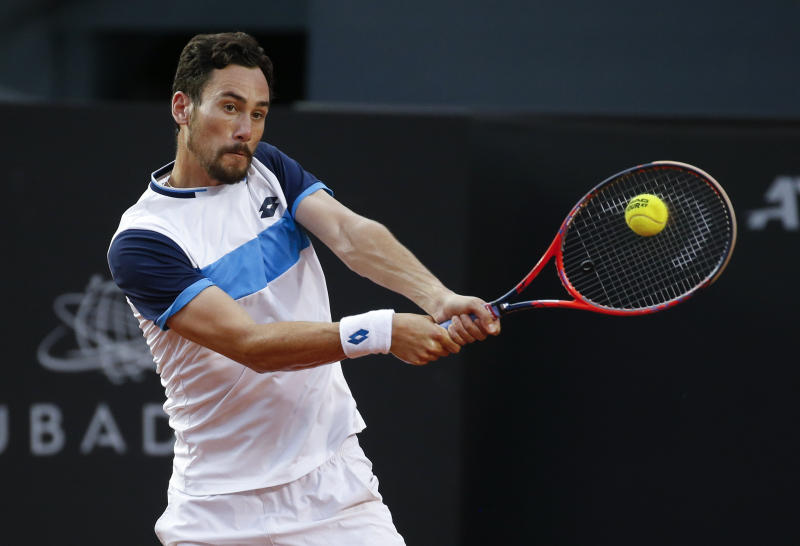Italy's Gianluca Mager returns the ball to Cristian Garin during the final match at the Rio Open tennis tournament in Rio de Janeiro, Brazil, Sunday, Feb. 23, 2020. (AP Photo/Luciano Belford)