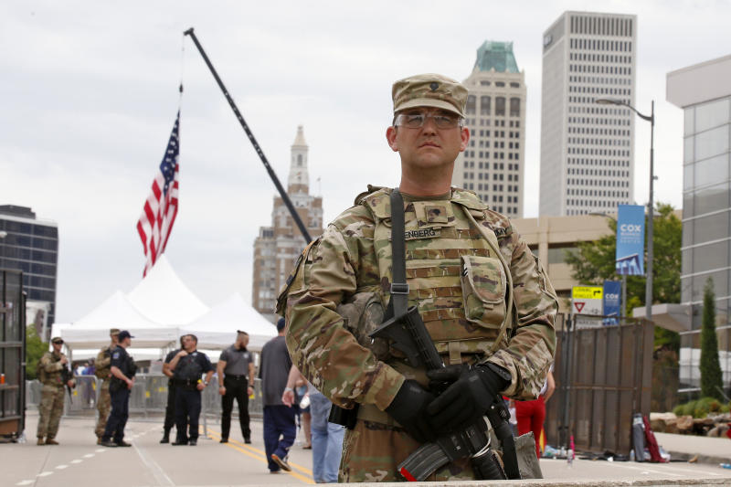 The National guard stands outside the BOK Center where President Trump will hold a rally in Tulsa, Okla., Saturday, June 20, 2020. (AP Photo/Sue Ogrocki)