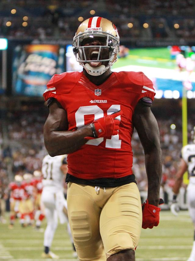 San Francisco 49ers wide receiver Anquan Boldin reacts after scoring on a 20-yard touchdown reception in second-quarter NFL football game action against the St. Louis Rams, Thursday, Sept. 26, 2013, in St. Louis. (AP Photo/St. Louis Post-Dispatch, Chris Lee)