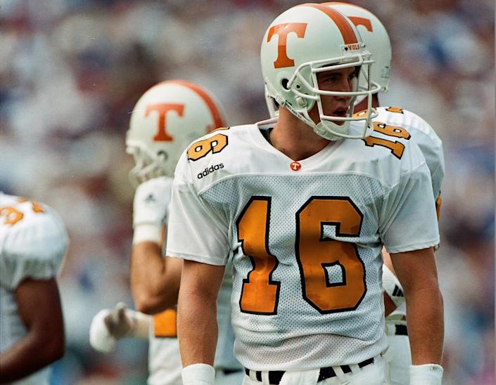 "<h1 class=""title"">Tennessee Volunteers vs. Florida Gators</h1> <div class=""caption""> USA - SEPTEMBER 20: Peyton Manning of the Tennessee Volunteers looks on against the Florida Gators on September 20, 1997. (Photo by Sporting News via Getty Images via Getty Images) </div> <cite class=""credit"">The Sporting News</cite>"