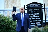US President Donald Trump holds up a bible in front of St John's Church after walking across Lafayette Park from the White House in Washington, DC on June 1, 2020, during Black Lives Matter protests against the killing of George Floyd a week earlier