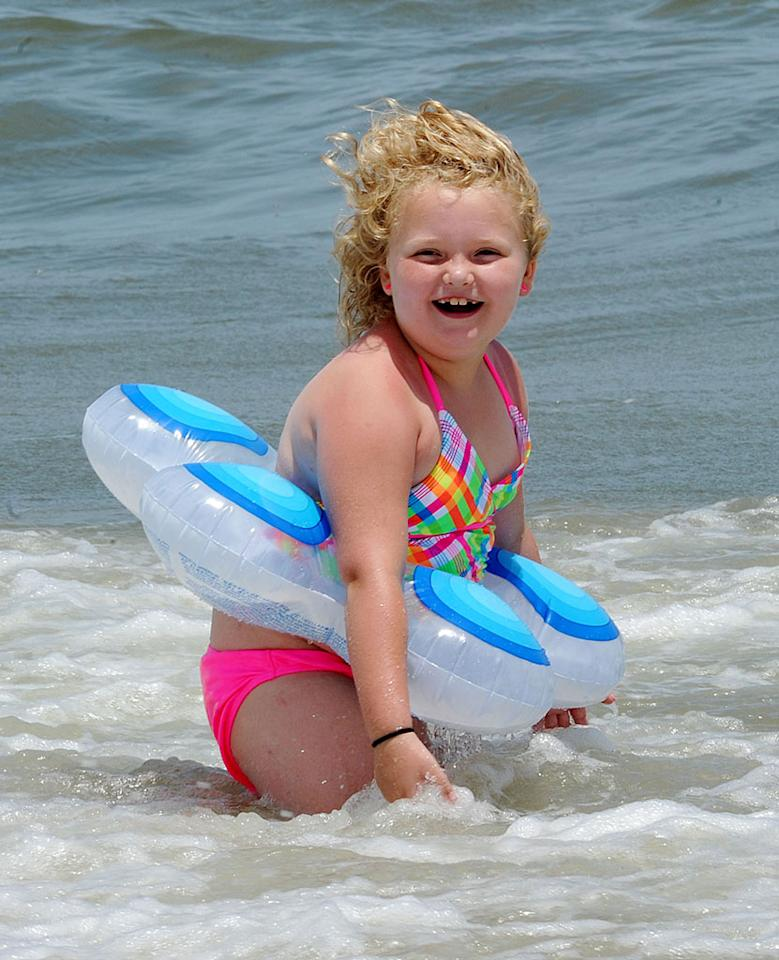 EXCLUSIVE: **NO WEB Until 1PM PSt** Honey Boo Boo and family hit the beach in Tybee Island, Georgia. The reality family had a few days off from filming their hit TV show 'Here Comes Honey Boo Boo'. Mama June was getting knocked over by the waves and Sugar Bear and their security guard had to go into the water to stand her up. Honey Boo Boo Alana had a blast with a tube tied around her waist while she went for a swim with her Dad Sugar Bear. The sisters buried Uncle Poodle into the sand and also Pumpkin.   Pictured: Alana 'Honey Boo Boo' Thompson  Ref: SPL560550 120613  EXCLUSIVE  Picture by: Jason Winslow / Splash News     Splash News and Pictures  Los Angeles:310-821-2666  New York:212-619-2666  London:870-934-2666  photodesk@splashnews.com