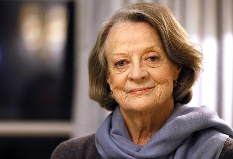 "FILE - In this Dec. 16, 2015, file photo, British actress Dame Maggie Smith poses in London. When Smith wasn't present for her Emmy win on Sunday, Sept. 18, 2016, host Jimmy Kimmel took the statuette from presenter Minnie Driver and said, ""We're not mailing this to her. Maggie, if you want this, it will be in the lost and found."" Smith responded on Twitter Monday, Sept. 19, 2016, writing, ""If Mr. Kimmel could please direct me to the lost and found office I will be on the next flight."" (AP Photo/Kirsty Wigglesworth, File)"