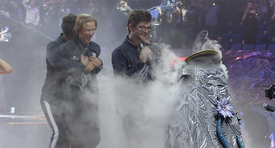 OG claiming the TI9 Aegis after their historic win at the Mercedes-Benz Arena in Shanghai, China.