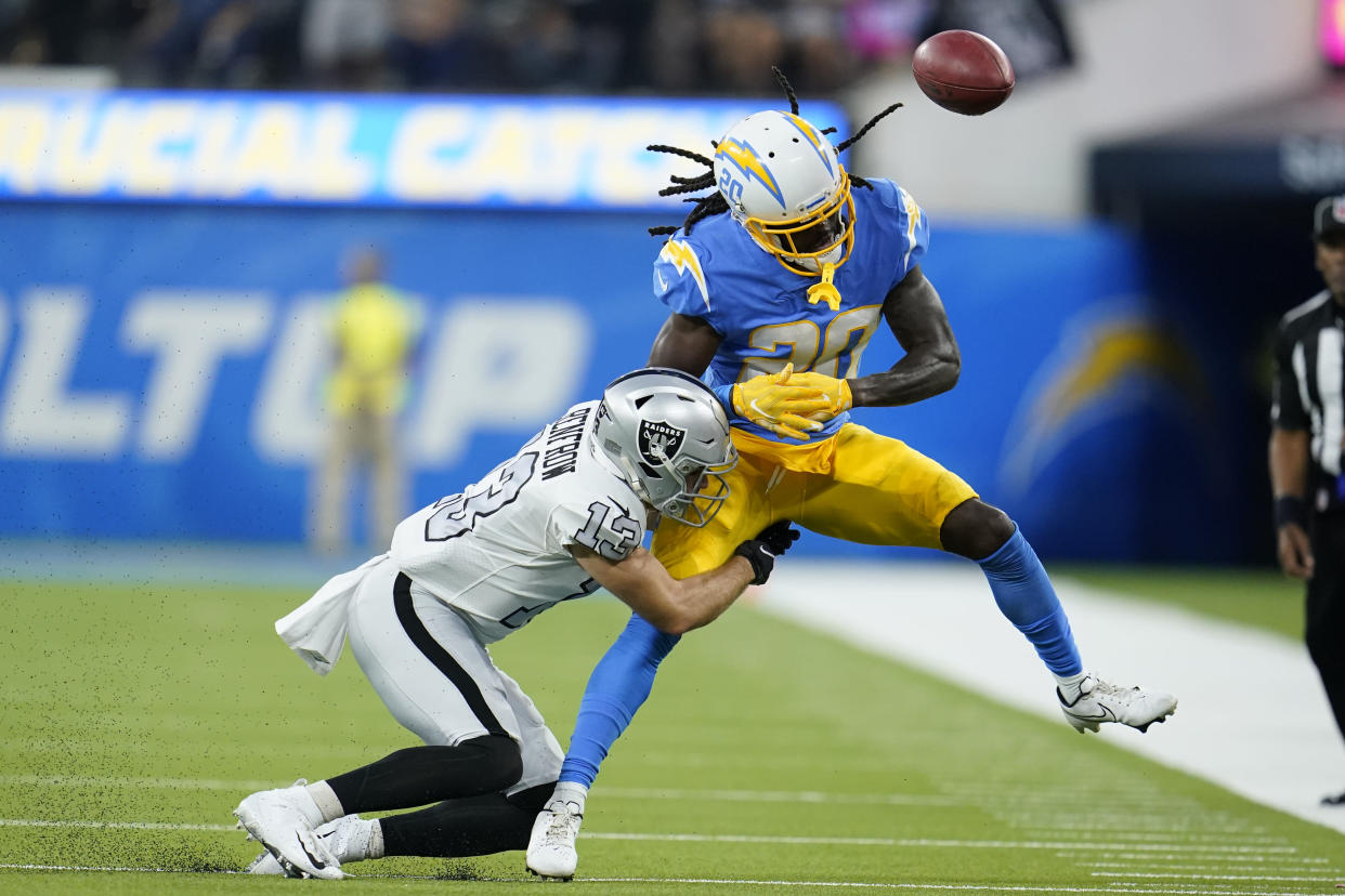 Los Angeles Chargers defensive back Tevaughn Campbell can't make the catch as he is hit by Las Vegas Raiders' Hunter Renfrow. (AP Photo/Marcio Jose Sanchez)