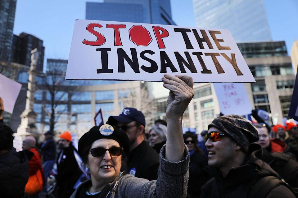 <p>Marchers wave signs in Manhattan. (Photo: Getty Images) </p>