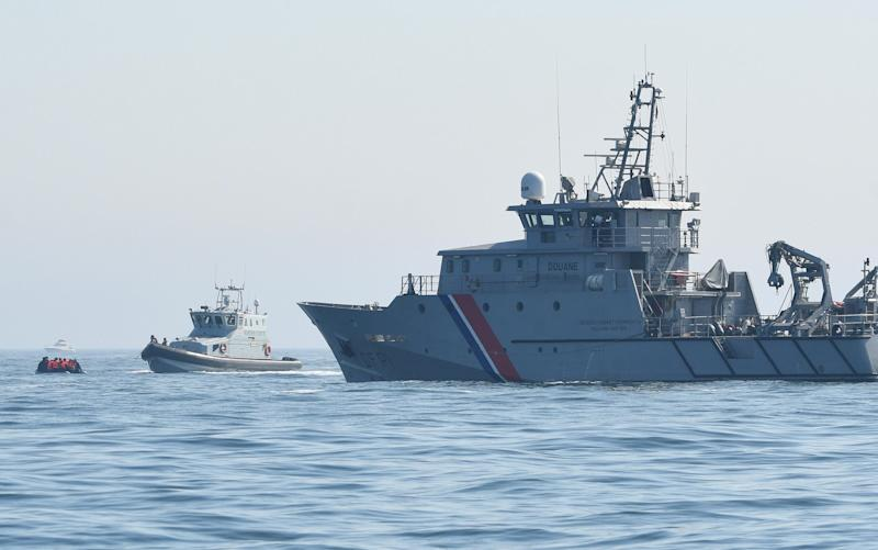 A migrant boat, with a Border Force vessel, and a French navy ship - Steve Finn