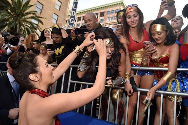 <p>Gadot greets the Wonder Women in the crowd. (Photo: Alberto E. Rodriguez/Getty Images) </p>