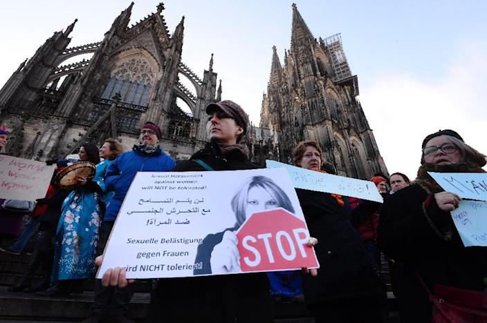 This photo from January 9, 2016 shows a woman protesting in Cologne, Germany, where hundreds of men, who were believed to be illegal North African migrants, allegedly sexually assaulted women during New Year's Eve celebrations (AFP Photo/Roberto Pfeil)