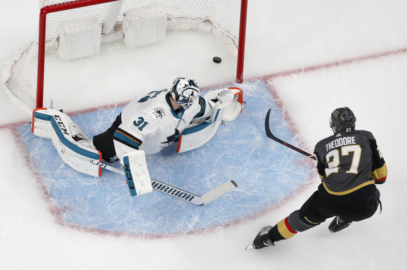 Vegas Golden Knights defenseman Shea Theodore (27) scores on San Jose Sharks goaltender Martin Jones (31) during the first period of Game 4 of a first-round NHL hockey playoff series Tuesday, April 16, 2019, in Las Vegas. (AP Photo/John Locher)