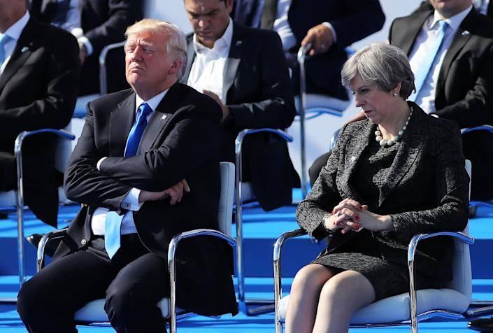Trump and British Prime Minister Theresa May are pictured ahead of a photo opportunity of leaders as they arrive for a NATO summit meeting in Brussels, Belgium, on May 25.