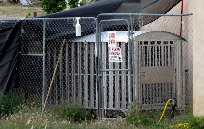 "The kennel to a drug-sniffing police dog Nikka of Vaughn, N.M. is shown in backyard of former Vaughn Police Chief Ernest ""Chris"" ArmijoWednesday, Wednesday, Sept. 26, 2012. Vaughn officials announced Wednesday that Armijo resigned after news stories reported that he was not allowed to carry a gun due to his criminal record, leaving the town with just one certified member on its police- force a drug-sniffing dog named Nikka. The town's only other officer isn't certified and pleaded guilty to charges of assault and battery last year. (AP Photo/Russell Contreras)"