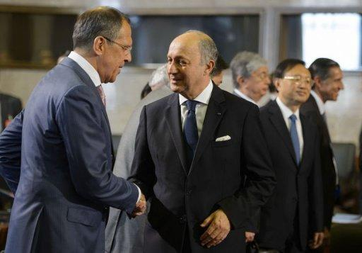 Russian Foreign Minister Sergei Lavrov (L) greets French Foreign Minister Laurent Fabius at the start of a crisis meeting on Syria at the United Nations office in Geneva. Lavrov said that Moscow had convinced other parties to accept that the transition would be decided by Syrians and that no party should be excluded from the process