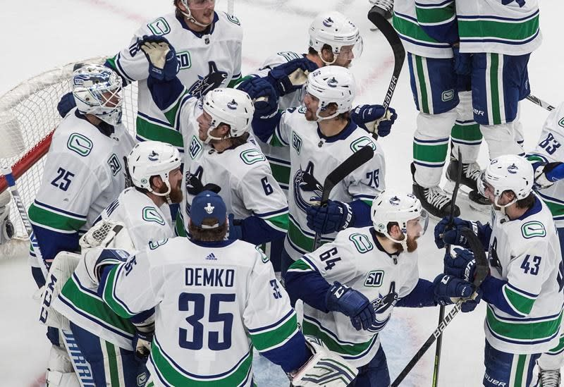 Canucks rally from two-goal deficit, beat Blues 4-3 in NHL playoff action