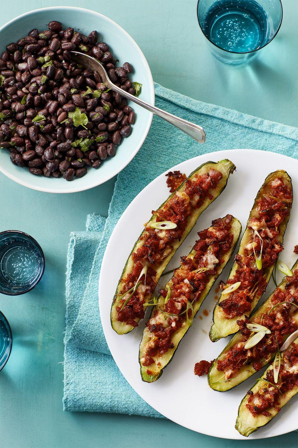 """<p>Get your veggies in by baking spicy chorizo and Pepper Jack cheese into hollowed out zucchini.</p><p><em><a href=""""https://www.womansday.com/food-recipes/food-drinks/recipes/a58989/tex-mex-stuffed-zucchini-black-beans-recipe/"""" rel=""""nofollow noopener"""" target=""""_blank"""" data-ylk=""""slk:Get the Tex Mex Stuffed Zucchini with Black Beans recipe."""" class=""""link rapid-noclick-resp"""">Get the Tex Mex Stuffed Zucchini with Black Beans recipe.</a></em></p>"""