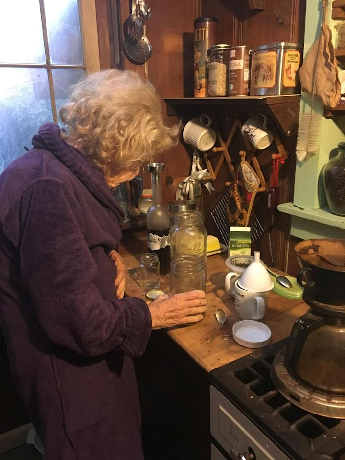 Mary, an 82-year-old former nun, makes herself a tincture of marijuana leaves and Grey Goose vodka, which she says helps her sleep at night. Mary moved to the valley in 1973, and became a poet. (Photo: Deleigh Hermes for Yahoo News)