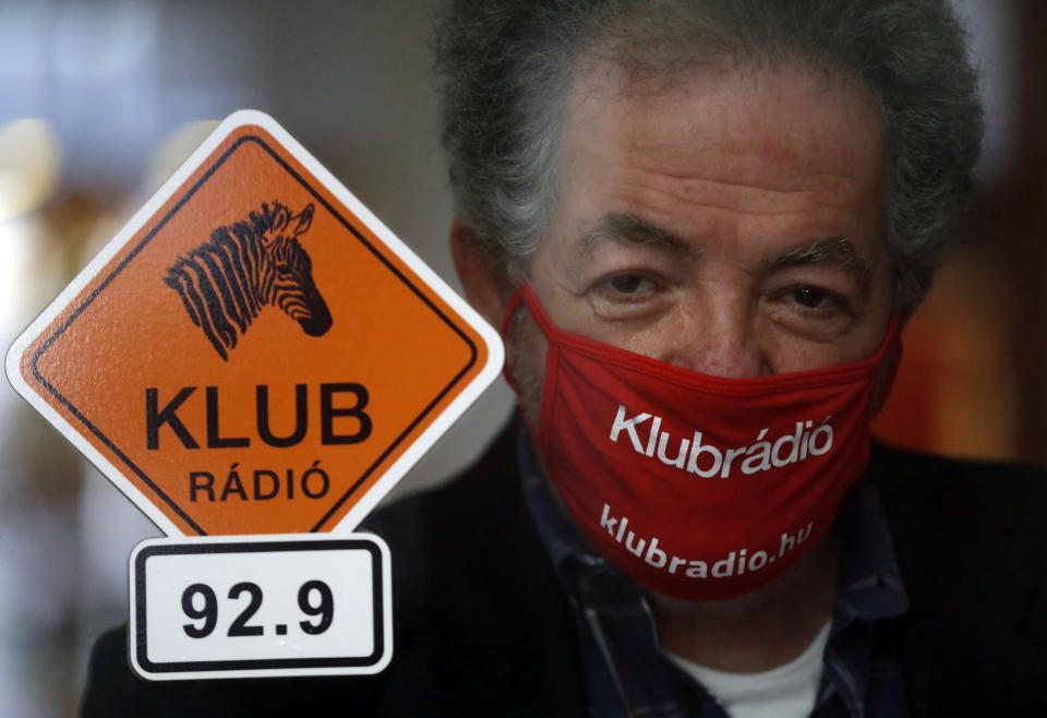 Andras Arato, Klubradio's director and CEO is seen in the studio of Klubradio in Budapest, Tuesday, Feb. 9, 2021. One of Hungary's last remaining independent radio stations will be forced off the airwaves and limited to online broadcasts after a court upheld a decision by media regulators not to extend its broadcasting license. The court dismissed a challenge brought by Klubradio, a liberal-leaning commercial station broadcasting in Budapest. (AP Photo/Laszlo Balogh)