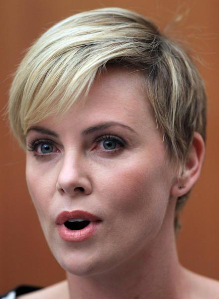 """South African-born Hollywood actress Charlize Theron speaks during her joint media conference with South African President Jacob Zuma, unseen, after their meeting at his Union Building office in Pretoria, South Africa, Monday, 29 July 2013. They discussed the fight against HIV and Aids, and """"how collaboration can assist mitigate the pandemic's negative impact on young girls"""". (AP Photo/Themba Hadebe)"""
