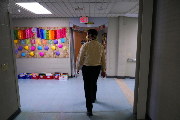 Principal Rob Palazzo walks down a hall at Panther Valley Elementary School, Thursday, March 11, 2021, in Nesquehoning, Pa. On May 26, 2020, former student, 9-year-old Ava Lerario; her mother, Ashley Belson, and Ava's father, Marc Lerario, were found fatally shot inside their home. Palazzo says he and the rest of the school and community are grappling with the what-ifs: What if school had been open, and they had a chance to save Ava? (AP Photo/Matt Slocum)