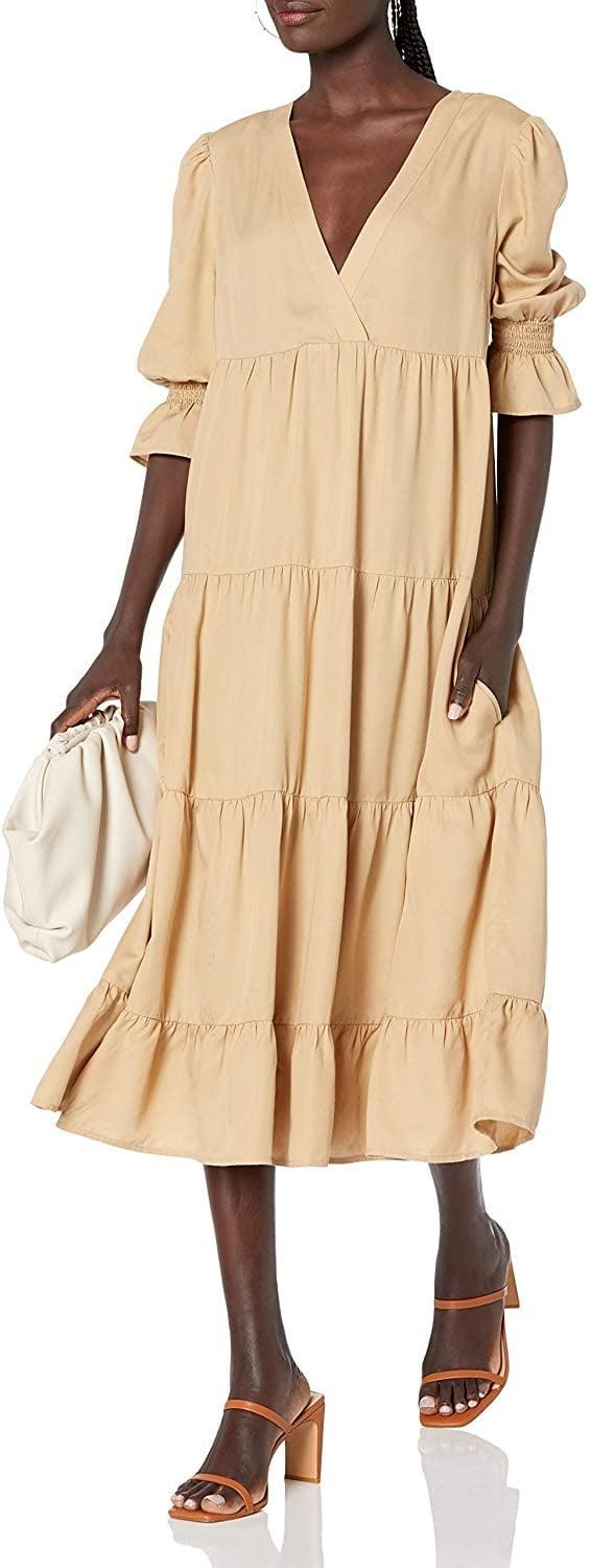 <p>On days when you have to dress up but you don't feel like it, this <span>The Drop Belle Puff-Sleeve V-Neck Tiered Midi Dress</span> ($60) will do the trick. People won't even know you got ready in a hurry, it's that polished!</p>