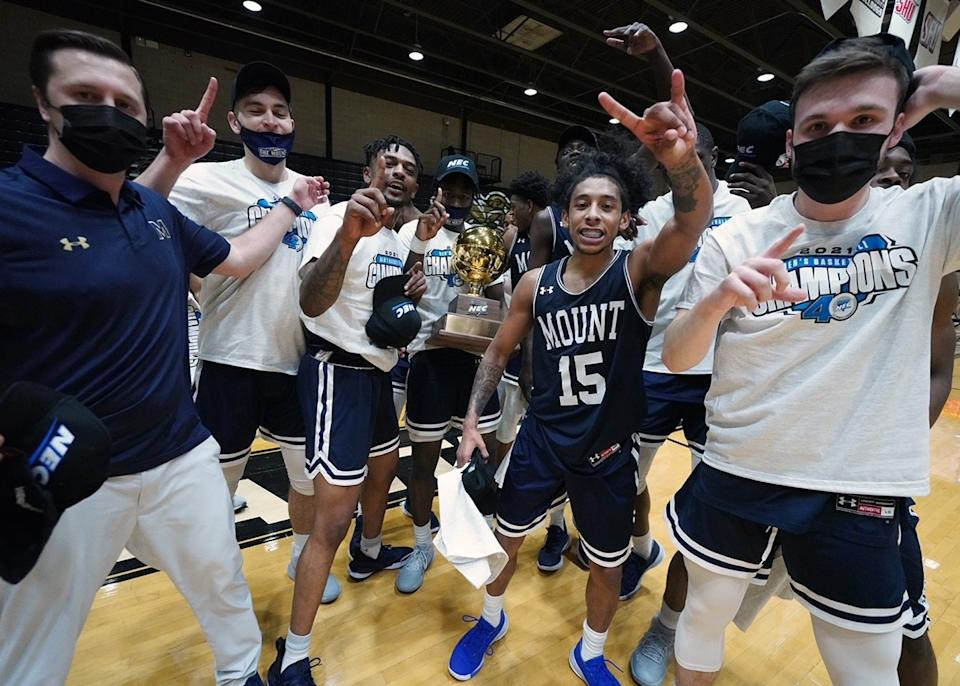 Mount St. Mary's point guard Damian Chong Qui celebrates with his teammates after the win. (Credit: David Silverman Photography/DSPics.com)