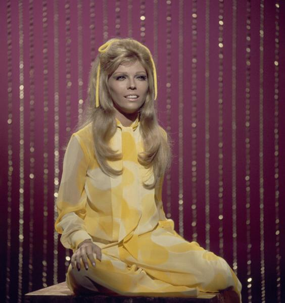 """<div class=""""caption-credit""""> Photo by: Photo by NBC/NBCU Photo Bank via Getty Images</div><b>Mellow yellow, 1960s</b> <br> There's that adorable hair bow again! Yup, we're trying it. We're slightly intimidated by her patterned, tie-neck jumpsuit, but Nancy totally pulled it off in her day. <br>"""