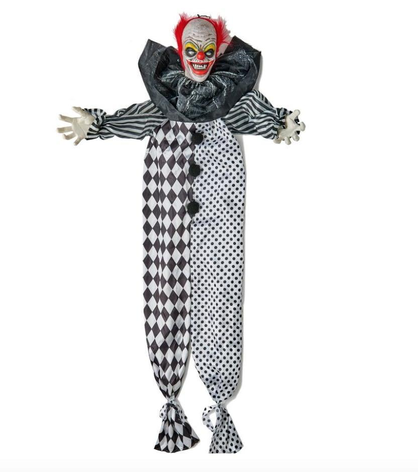 <p>Designed to be hung from any ceiling or doorway, this <span>Animated Clown</span> ($52) is five feet of pure terror! Onlookers will be downright petrified by this character's flashing eyes, rapid arm movements, and voice-activated clown laughs, which are sure to send chills down your spine. </p>
