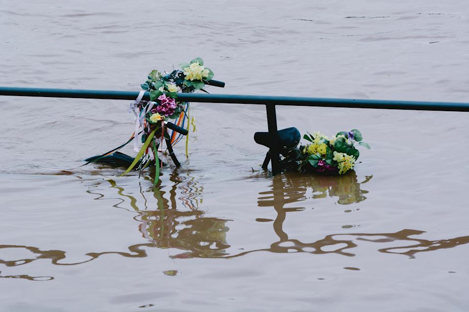 a bicycle is seen under the water from Rhine river in Cologne, Germany on July 15, 2021 as NRW experienced flooding after large amount of rain fell (Photo by Ying Tang/NurPhoto via Getty Images)